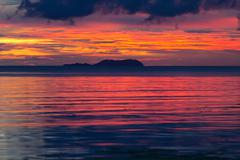 dramatic fiery orange sunset in siquijor - stock photo