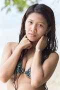 attractive filipina woman with a serious look - stock photo