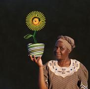 south african zulu woman basket sales woman blackboard sunflower - stock photo
