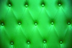 Emerald green color of upholstery leather pattern as background Stock Photos