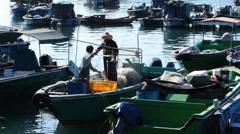Time Lapse  Chinese Fisherman sorting net Cheung Chau island shelter Hong Kong Stock Footage