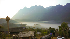 Timelapse : Beautiful scenery with dense layer of fog among mountain peaks - stock footage