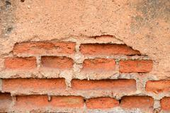 old red grunge brick wall - stock photo