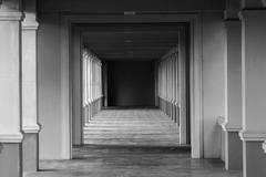 perspective view through several open doors - stock photo