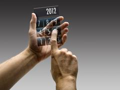 Two hands holding a calculator with 2012 included Stock Photos