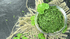 Heap of dried parsley (loopable) Stock Footage
