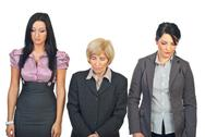 Stock Photo of Sad business women in a row