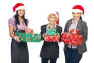 Stock Photo of Business women with Christmas gifts