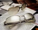 Stock Photo of open journals with glasses in front