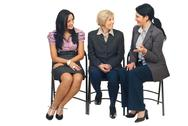 Stock Photo of Three business women having conversation