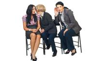 Stock Photo of Business women tells secrets