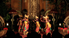 Balinese dancers in traditional costume performing on stage in the Legong dance Stock Footage