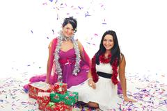 Christmas women at party  with confetti and gifts - stock photo