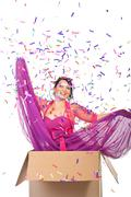 Elegant woman out of the box - stock photo