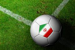 Stock Illustration of iran flag pattern of a soccer ball in green grass