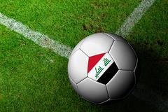 Stock Illustration of iraq flag pattern of a soccer ball in green grass