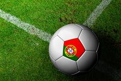 Stock Illustration of portugal flag pattern of a soccer ball in green grass