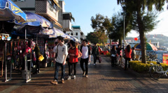 Cheung Chau island promenade waterfront narrow street Bicycle ceremonial Arches - stock footage