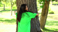 Stock Video Footage of Happy environmental activist hugging a tree