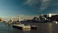 Tower Bridge, HMS Belfast and the River Thames, London, UK Stock Footage