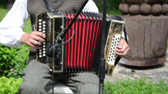 Accordionist young man play music with accordion Stock Footage