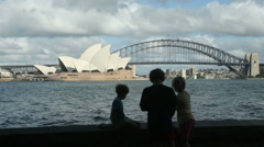 Children fishing, sydney opera house and harbour bridge, Australia Stock Footage