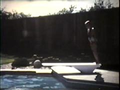 Young girl dives into pool, side shot, 1977 Stock Footage