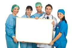 Cheerful doctors with blank banner Stock Photos