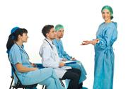Stock Photo of Confused surgeon woman at seminar