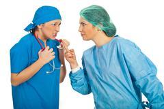 Stock Photo of Furious doctors women argue