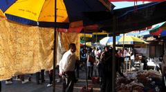 Vendors Stalls Hawkers at promenade waterfront Cheung Chau island street scene - stock footage