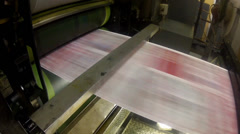 Rollers view. print press roll paper goes through the rollers for newspaper Stock Footage