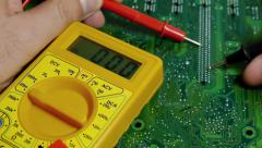 Stock Video Footage of Technician Working Volt Meter on Computer Terminals.