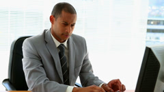 Businessman working at his desk Stock Footage