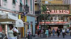Ariston Theatre Sanremo San Remo Building Neon Sign People Walking Sidewalk Day Stock Footage