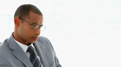 Businessman thinking at his desk Stock Footage