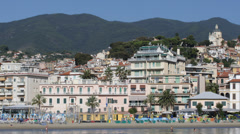 Sanremo Skyline Italian Riviera Resort People Sunbathing Swim Sandy Beach Sea Stock Footage