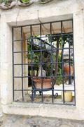Wrought iron railing in the window. Stock Photos