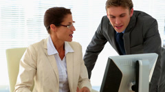 Stock Video Footage of Business people talking together at desk