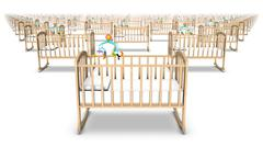 Side view of endless rows of Baby Cribs Stock Photos