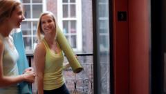Friends Wait For Elevator, Get On, To Go To Yoga Class Stock Footage