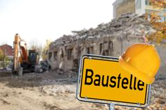 house demolition with sign and the german word construction - stock photo
