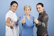 Stock Photo of Successful  business women giving thumbs up