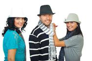 Stock Photo of Elegant three people with hats