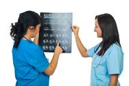Stock Photo of Two doctors women examine MRI