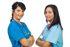 Two physicians women smiling - stock photo
