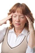 Senior woman with headache isolated Stock Photos