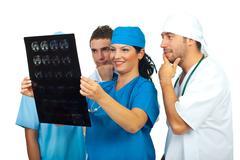 Team of doctors examine a magnetic resonance Stock Photos