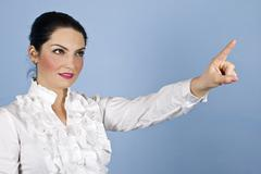 Business woman pointing up to copyspace - stock photo