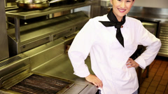 Happy chef smiling at camera beside the stove Stock Footage